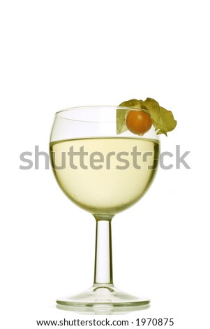 a glass of white wine spritzer garnished with a physallis - stock photo