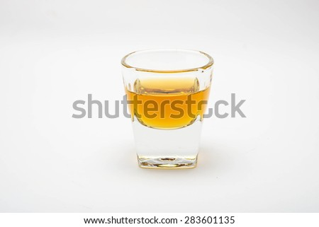 a glass of wisky isolated