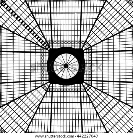 A glass skylight overhead creates a black and white pattern.