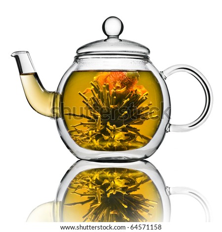 A glass tea pot with Flower Chinese tea isolated on a white background - stock photo