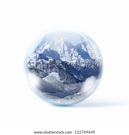 A glass transparent ball with snow high mountains inside it.