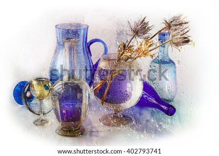 A glass vase of dried flowers on a blue background behind a wet glass .