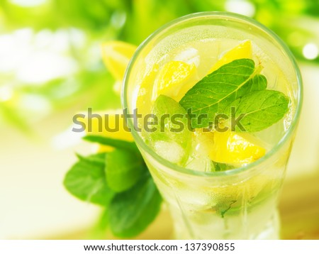 a glass  water with lemon and mint - stock photo