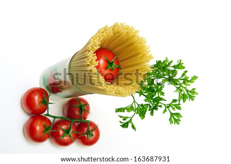A glass which are pasta and tomato on top