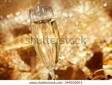 a glass with champagne in festive decoration