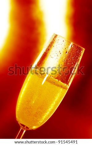 a glass with champagne on a red background