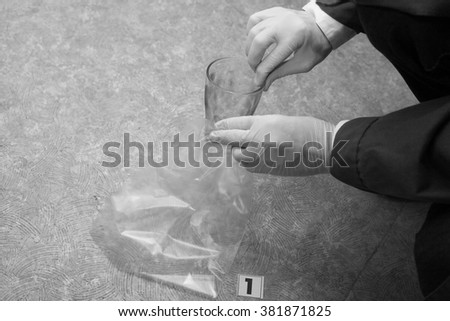 a glass with fingerprints. evidence. investigation of the crime. - stock photo