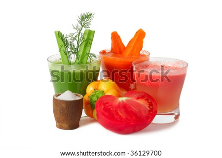 A glasses of fresh vegetable juice from tomatoes, carrot, celery and pepper  isolated on white background.