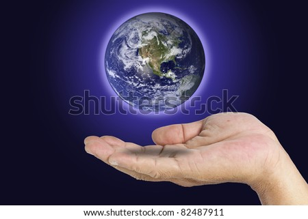 A global in one hand on dark blue background - stock photo