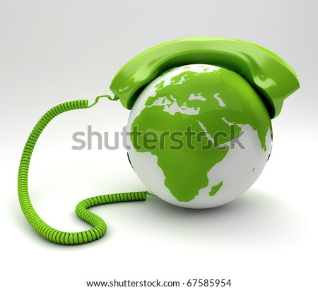 A global telecommunications concept - green phone and planet - stock photo