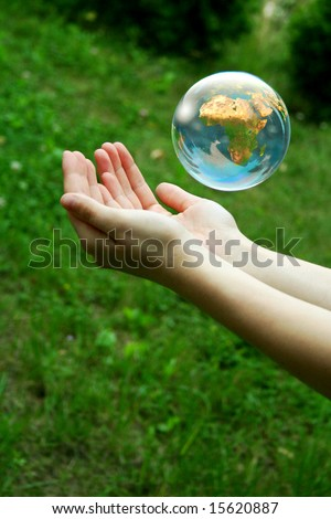A globe above the women hand - stock photo