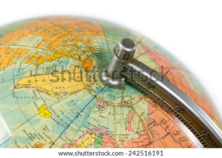 a globe in close-up in front of white Background - stock photo