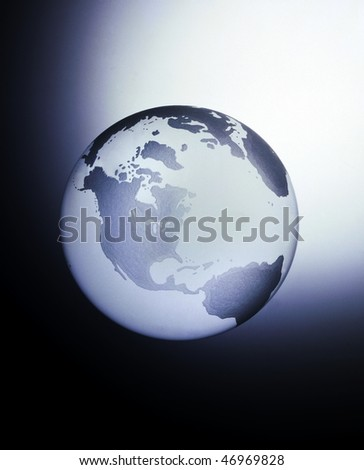 A globe made of glass with the main view of North America, Central and South America with space for copy - stock photo