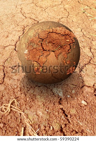 A globe on a deserts - stock photo