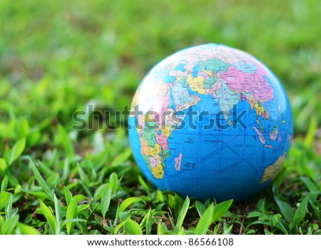 A globe on green grass concept - stock photo