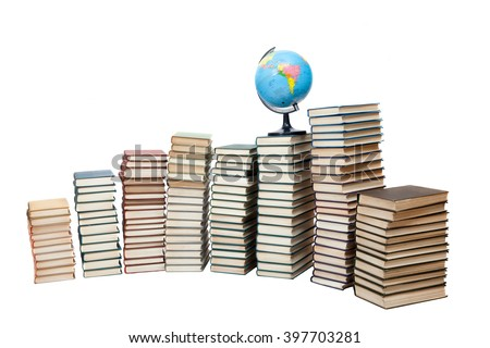 A globe on stacks of old books - stock photo