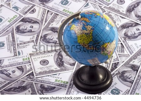 A globe with chinese wording over US dollar.