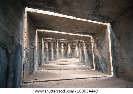 a gloomy concrete tunnel, can be used as a concept regarding depression and destress - stock photo