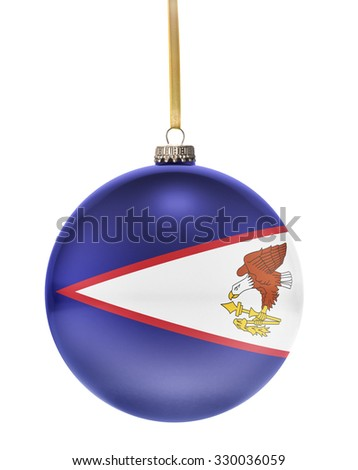 A glossy christmas ball in the national colors of American Samoa hanging on a golden string isolated on a white background.(series) - stock photo