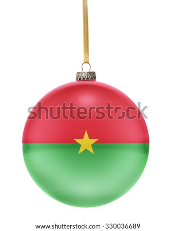 A glossy christmas ball in the national colors of Burkina Faso hanging on a golden string isolated on a white background.(series) - stock photo