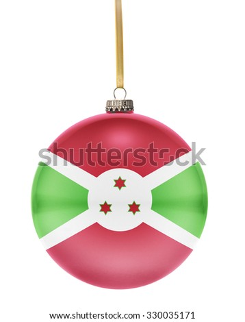 A glossy christmas ball in the national colors of Burundi hanging on a golden string isolated on a white background.(series) - stock photo