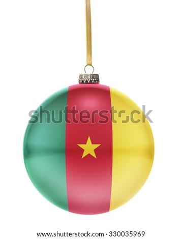 A glossy christmas ball in the national colors of Cameroon hanging on a golden string isolated on a white background.(series) - stock photo