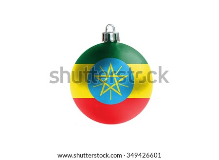 A glossy christmas ball in the national colors of cEthiopia isolated on a white background.  - stock photo
