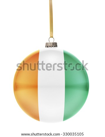 A glossy christmas ball in the national colors of Ivory Coast hanging on a golden string isolated on a white background.(series) - stock photo
