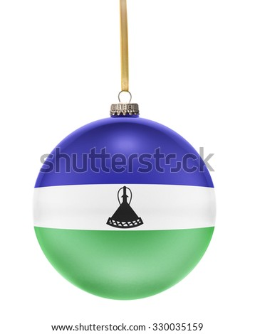 A glossy christmas ball in the national colors of Lesotho hanging on a golden string isolated on a white background.(series) - stock photo