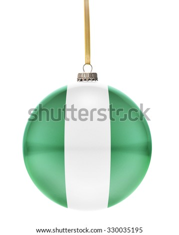 A glossy christmas ball in the national colors of Nigeria hanging on a golden string isolated on a white background.(series) - stock photo