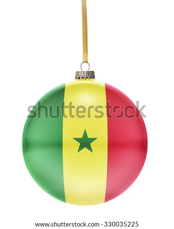 A glossy christmas ball in the national colors of Senegal hanging on a golden string isolated on a white background.(series) - stock photo