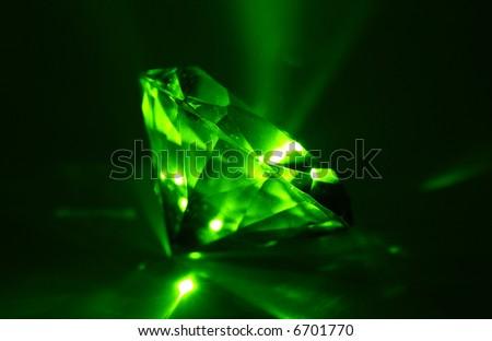 A Glowing Diamond Shaped Gem - Sapphire - Laser - stock photo