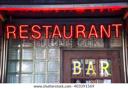A glowing restaurant bar neon sign image. - stock photo