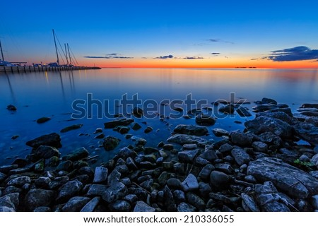 A glowing sunset sky illuminates the marina at Sister Bay in Door County, Wisconsin. - stock photo