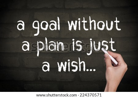 A Goal Without a Plan is Just a Wish / Motivational Inspirational Quote Wall Background - stock photo