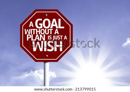 A Goal Without a Plan Is Just a Wish red sign with sun background - stock photo
