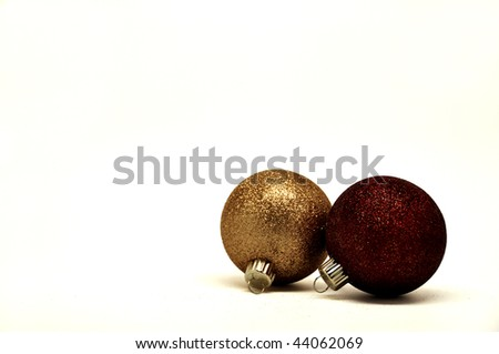 a gold and dark red christmas ornaments isolated over a white background - stock photo