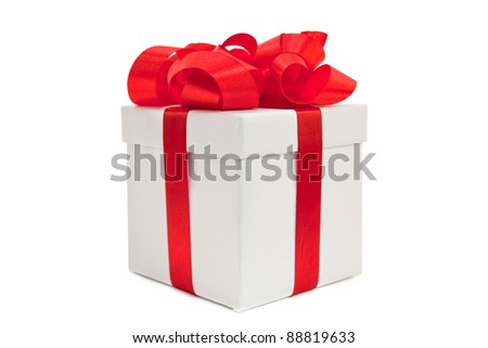 A gold box tied with a red satin ribbon bow. A gift for Christmas, Birthday, Wedding, or Valentine's day. Isolated on white with clipping path. - stock photo