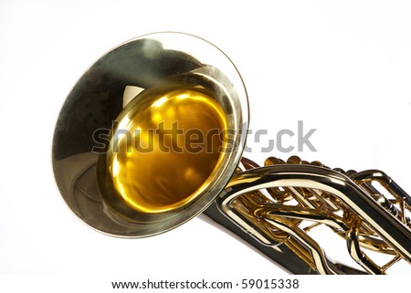 A gold colored brass tuba euphonium isolated on a white background in the horizontal format.