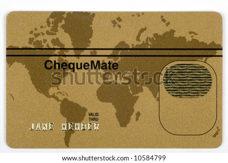 A gold credit card with the world map as a background. All numbers and names are fake. - stock photo
