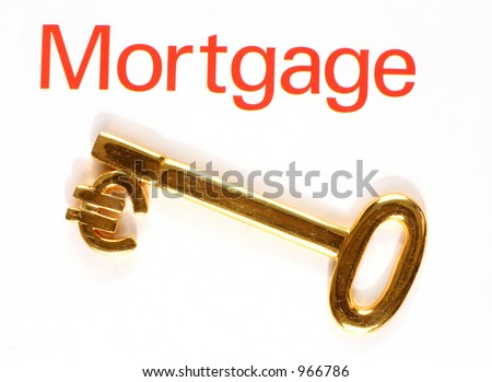 """A gold key with the euro currency symbol and the word """"mortgage"""" - stock photo"""