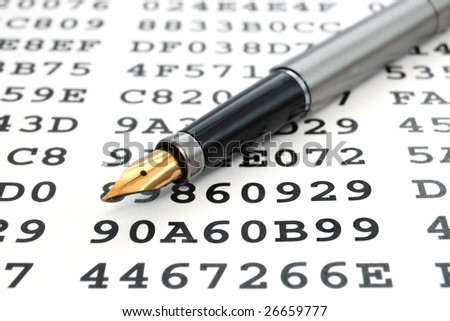 A gold-nibbed pen on a sheet with encrypted data - stock photo
