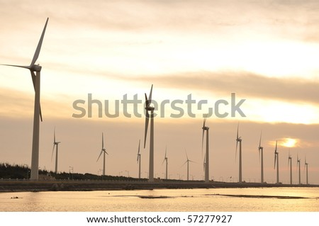 a gold sunset at the wind-power station