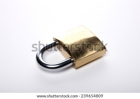 A gold(yellow) padlock(combination lock, bicycle lock) locked isolated white at the studio.