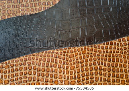 a golden brown background of the crocodile