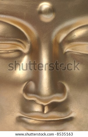 A golden buddha close up.