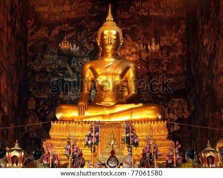 A golden Buddha statue in Thailand. - stock photo