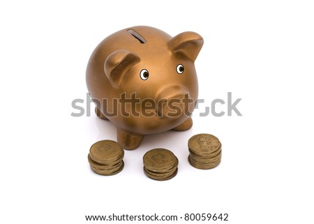 A golden coin bank and gold coins isolated on white, Saving for your retirement - stock photo