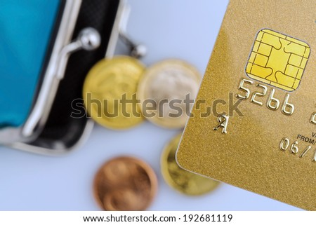 a golden credit card and an empty wallet. symbolic photo for cashless purchases and status symbols. - stock photo