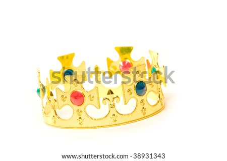 A golden crown with jewelry on white background - stock photo